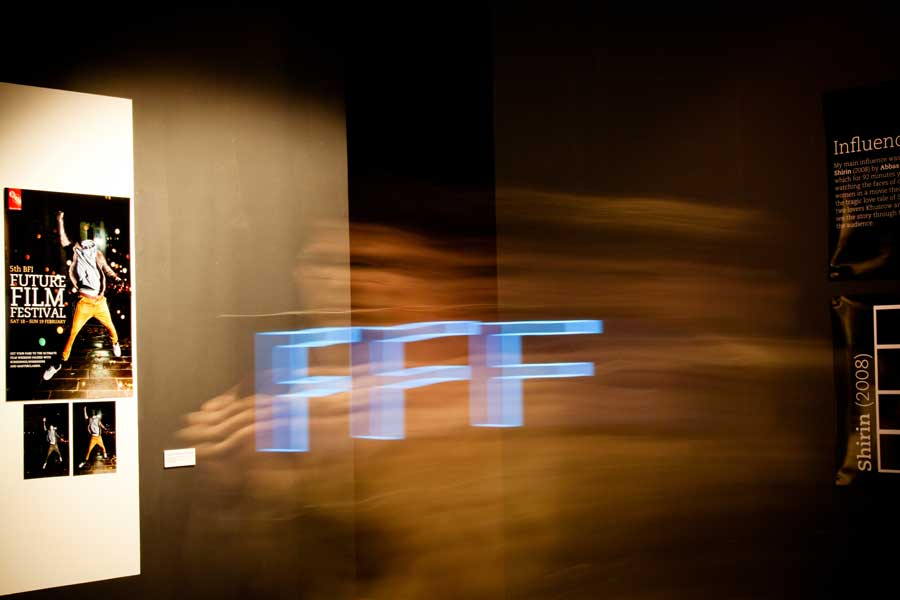 Pedro, an LCC student, having fun light-painting the Future Film Festival initials in front of the 2012 winner poster exhibition by Sam Mensah.  5th BFI Future Film Festival, 17-18 Feb 2012, BFI Southbank, London.
