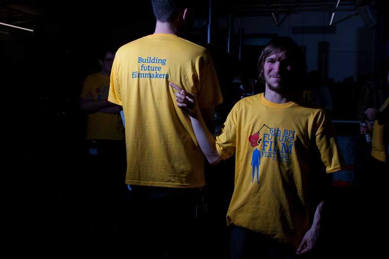 Staff wearing T-shirts with Michael Langdon's beautiful design.